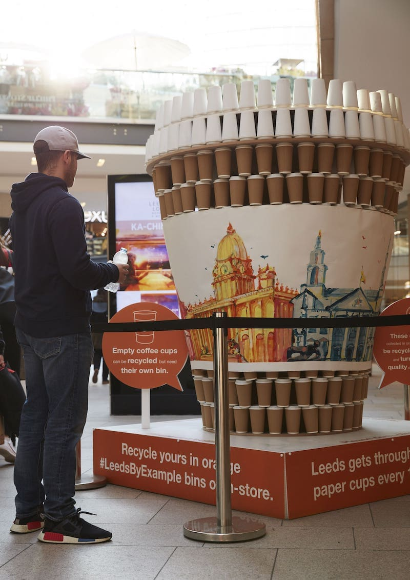 Photo of exhibition showing how many single use coffee cups we use in Leeds